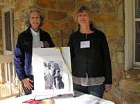 Gail McDowell and Anne Schafer with a photo of their parents, Dean and Mary McDowell